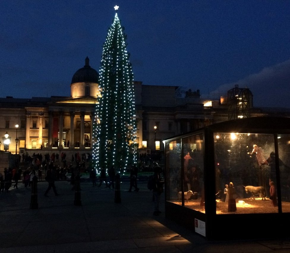 Tourists visit the Norwegian Trafalgar Square Christmas tree