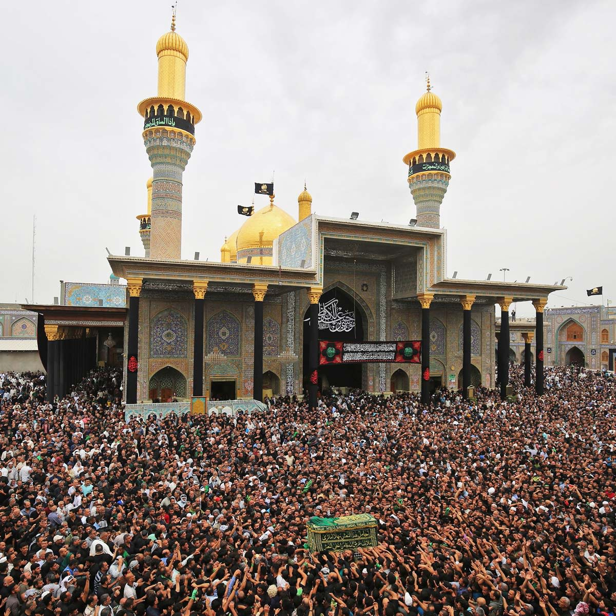 Shiite Muslim worshippers carry a symbolic casket as they gather at the Imam Moussa al-Kadhim's mosque in the Iraqi capital's northern district of Kadhimiya to mark the anniversary of the imam's death in the 8th Century.