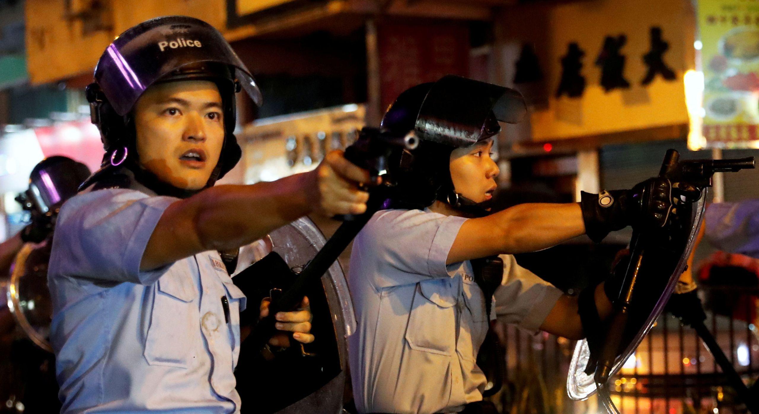 Police point guns