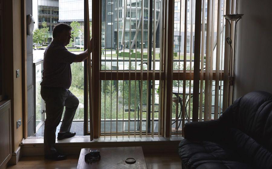 William standing in his apartment in Dublin