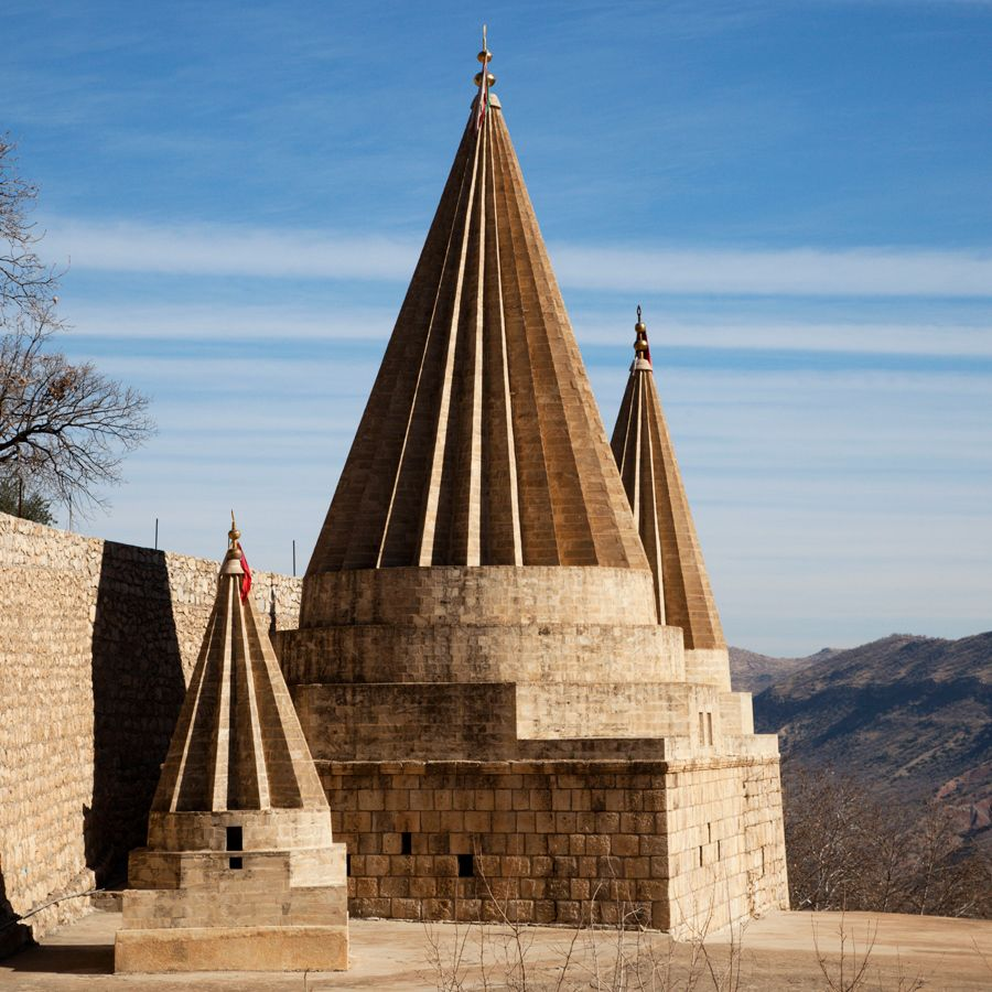 The iconic pointed spire of the Yazidis adorn the hills of the holy Yazidi temple of Lalish.
