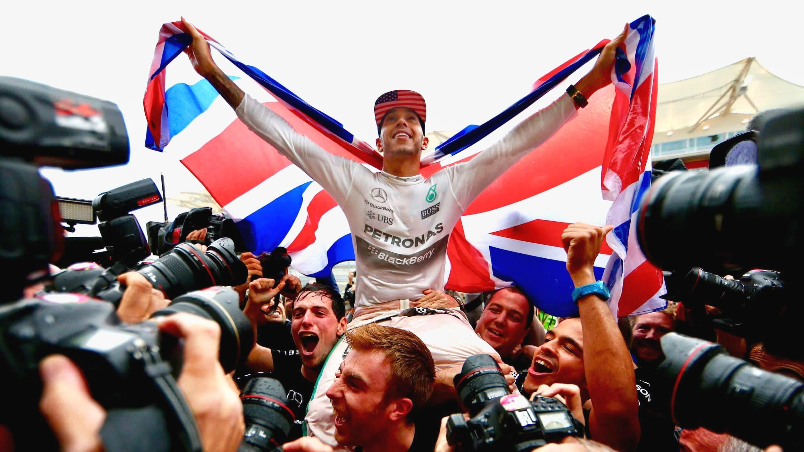 Lewis Hamilton celebrates with a Union Jack flag