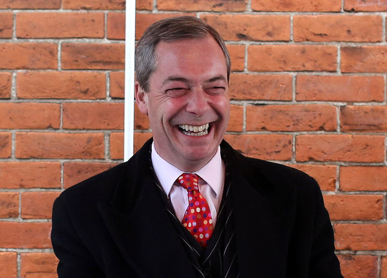 Nigel Farage grinning while seated