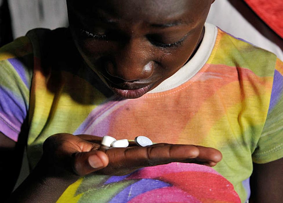 A child in Kenya taking ARV medication