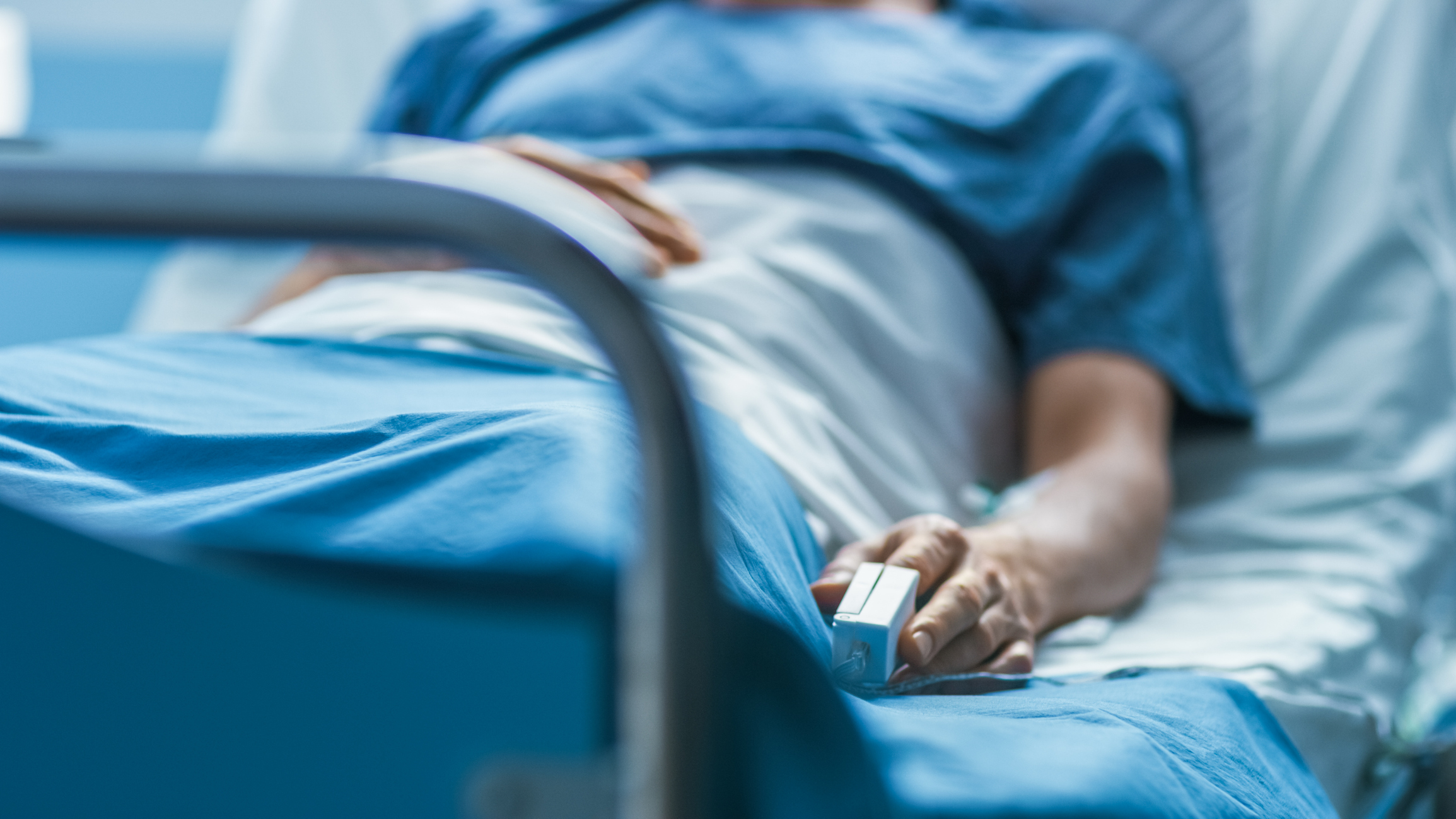 Stock image of patient in hospital bed