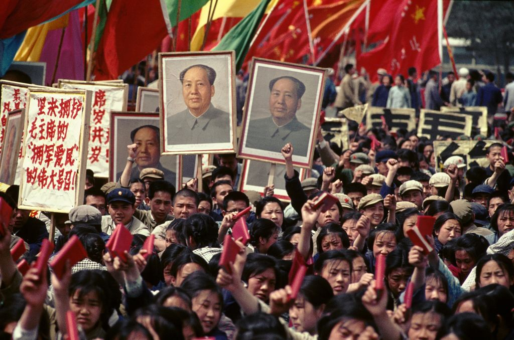 People holding pictures of Mao and the Little Red Book in Tiananmen Square, 1966