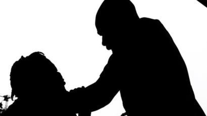 A man strangling a woman - stock image