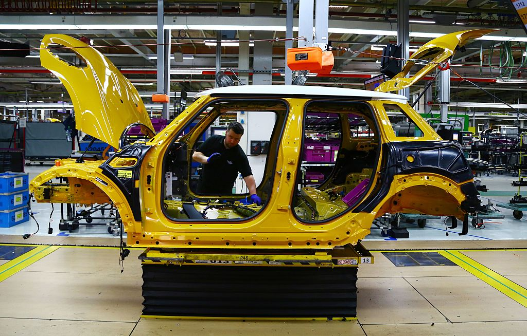 A car being assembled in a factory