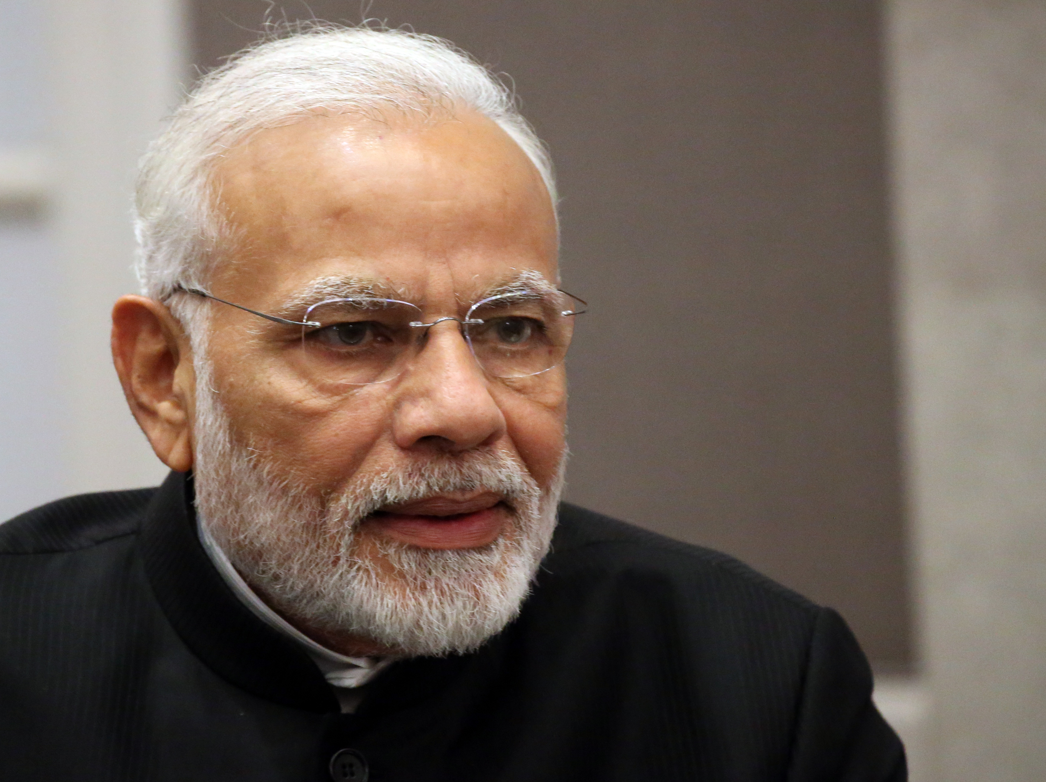 India's Prime Minister Narendra Modi alongside claim of country free of open defecation