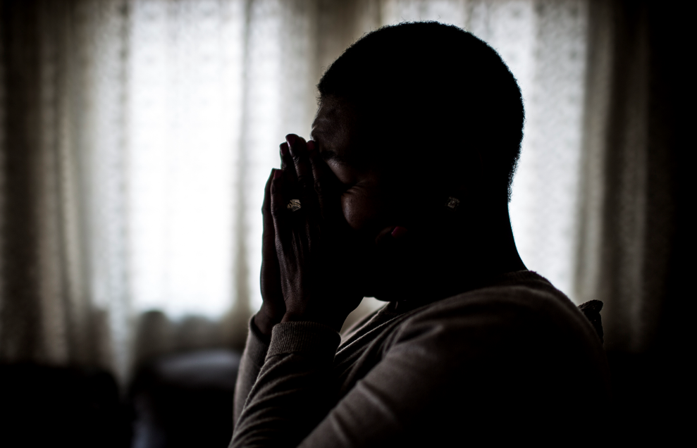 South African chef Nthabiseng Mabuza (pseudonym), 35 years old, cries at home on July 7, 2017, in Vosloorus, a middle-class township east of Johannesburg, after telling about her r