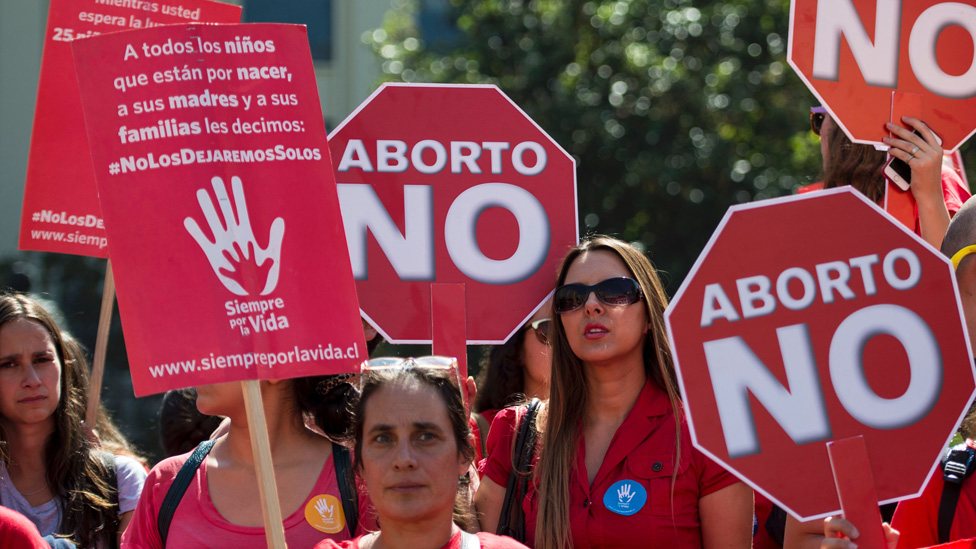 An activist takes part in a protest against abortion in front of La Moneda presidential Palace in Santiago on March 21, 2016.