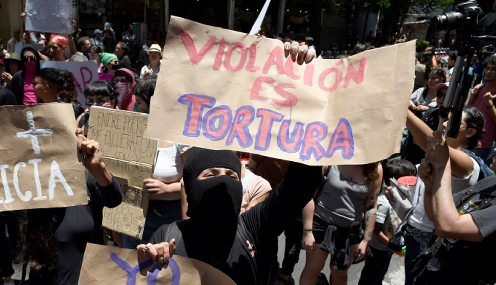 A woman protests after an alleged rape in Mexico City.
