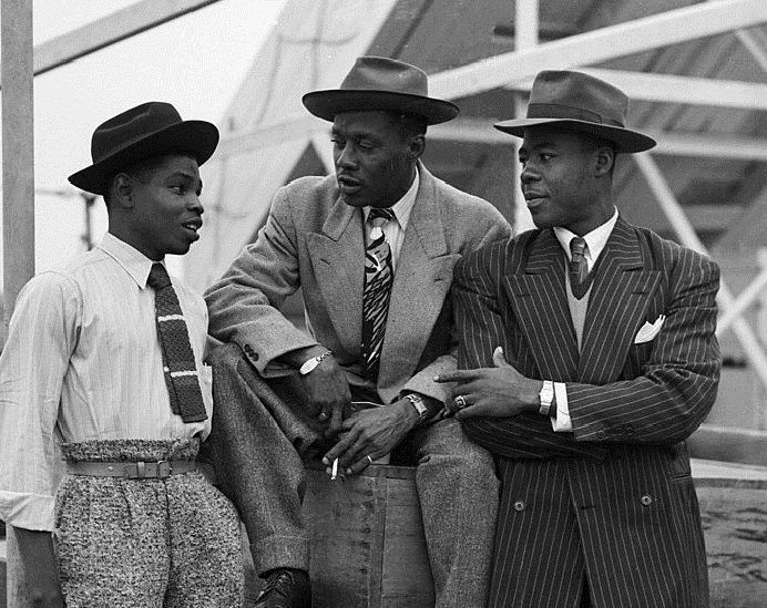 Three men onboard Empire Windrush