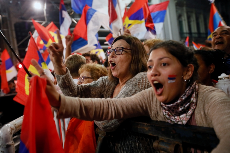 Supporters of presidential candidate Daniel Martínez celebrate in Montevideo