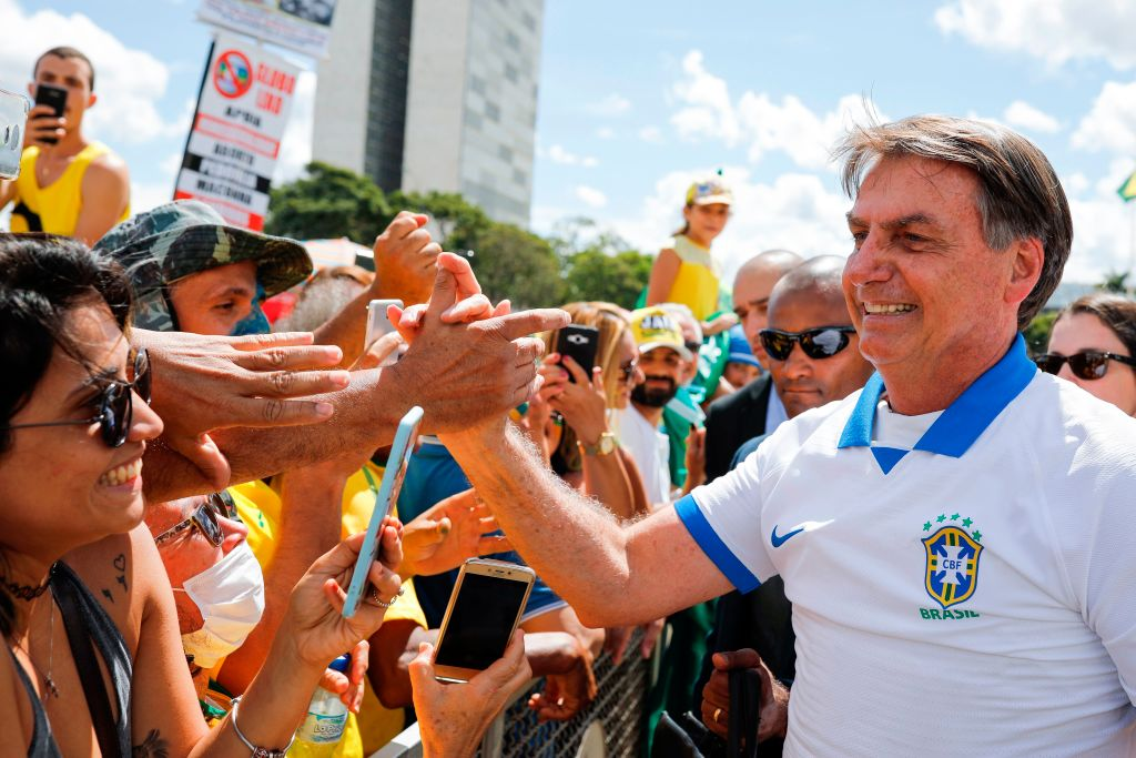 Brazilian president Jair Bolsonaro greets supporters on 15 March