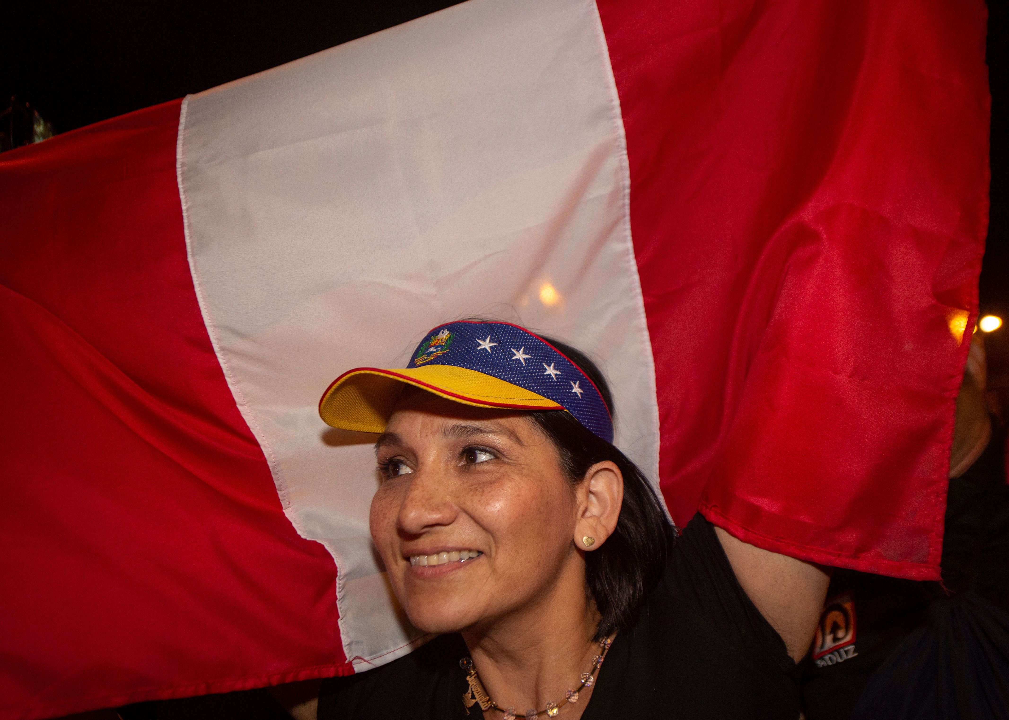 A Venezuelan woman waves a Peruvian flag at a protest against the government of President Maduro in Lima