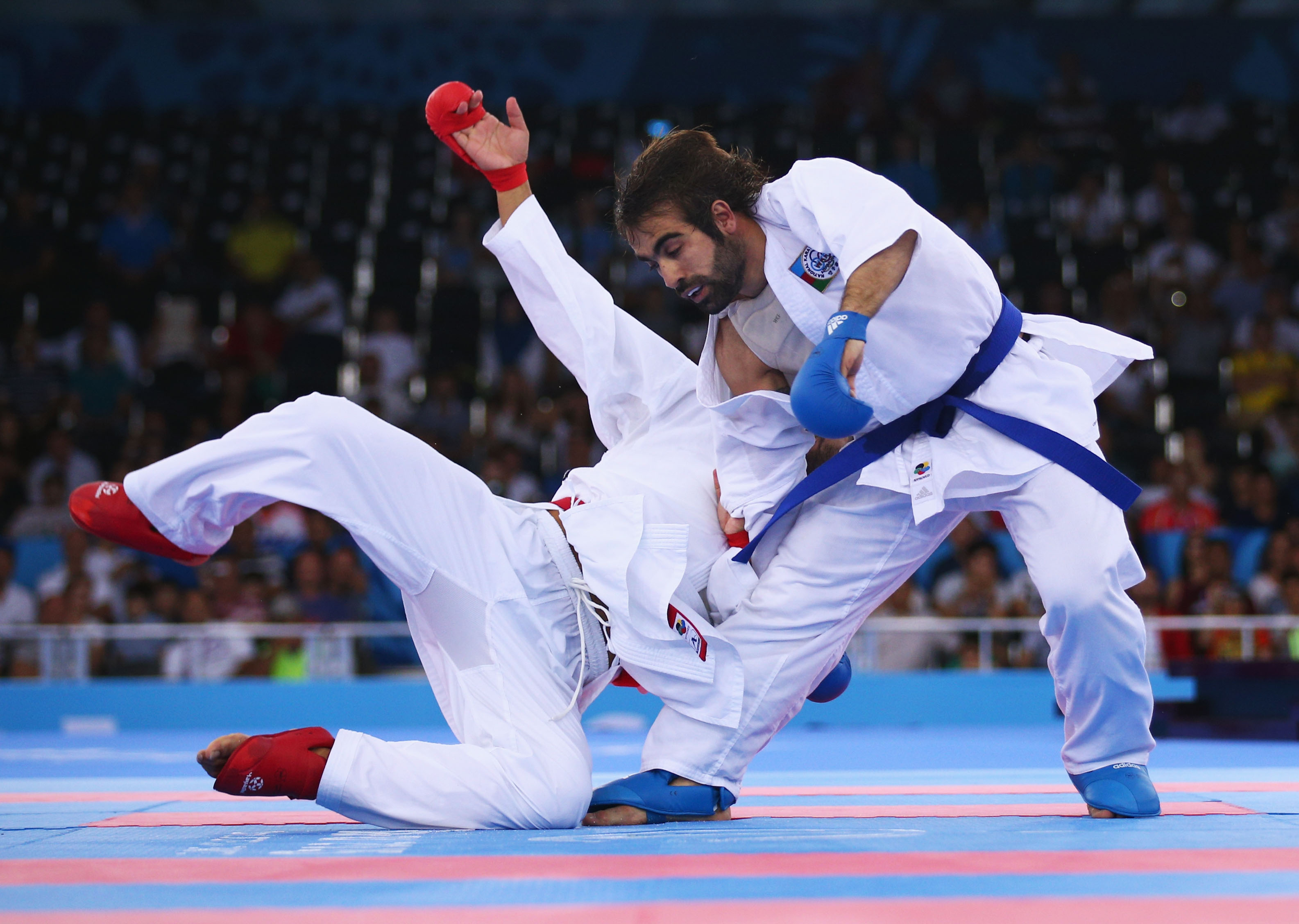 Rafael Aghayev of Azerbaijan (blue) competes with Luigi Busa of Italy (red) during the Men's Kumite -75kg final on day one of the Baku 2015 European Games, June 13, 2015.