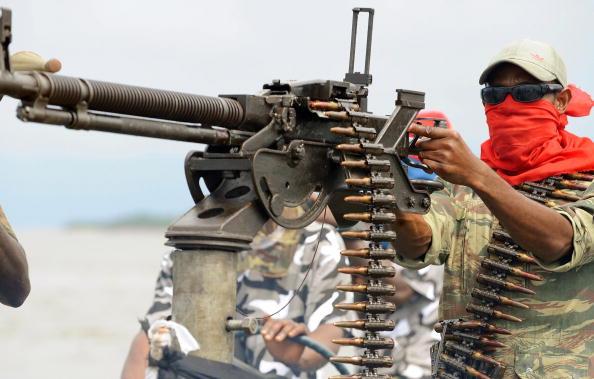 An oil militant in Nigeria's Niger Delta holding a machine gun
