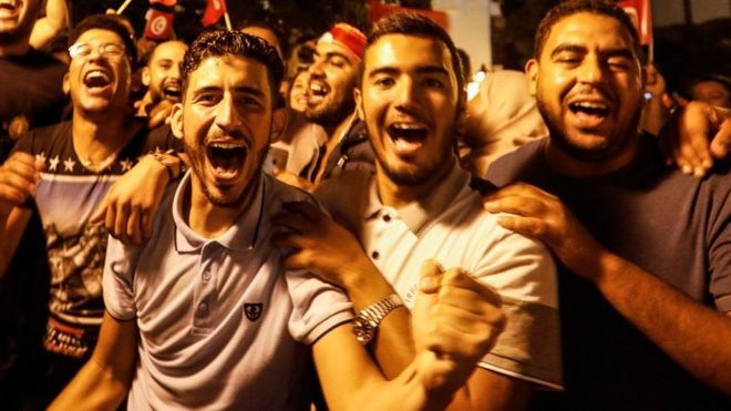 People in Tunis celebrating the victory of Kais Saied in Tunisia's presidential run-off