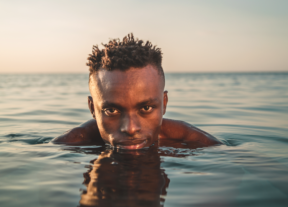 Photo of Chris Obehi in the sea