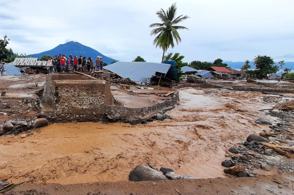 his picture taken on April 5, 2021 shows damaged homes after a flash flood in Waiwerang village, East Flores, as at least 157 people have been killed in Indonesia and neighbouring