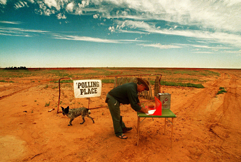 A farmer votes in an empty field on a remote farm in NSW, Australia