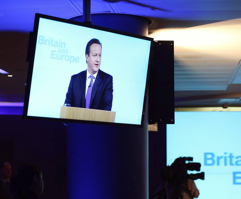 David Cameron appearing on a screen during a speech on Europe