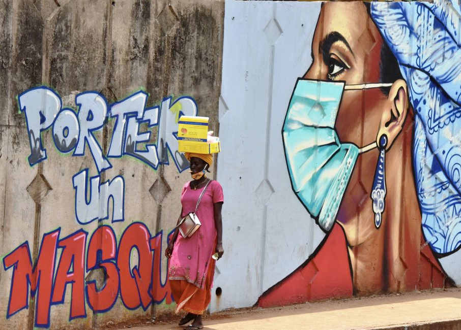 A mural of a woman wearing a face mask in Guinea