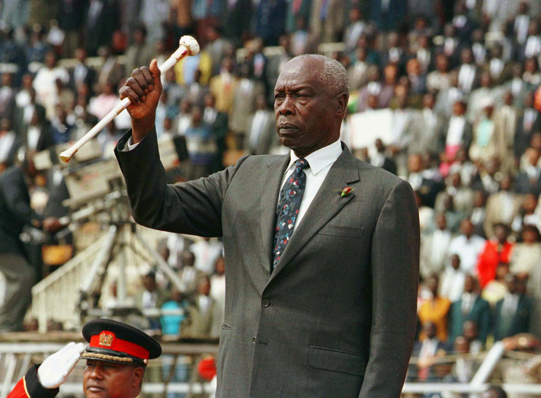 President Daniel Arap Moi raises his baton to salute Kenyans during the 34th independence day celebrations in Nairobi,