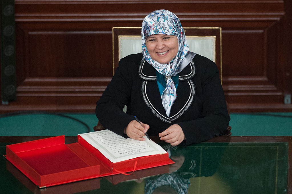 Female politician signing a document