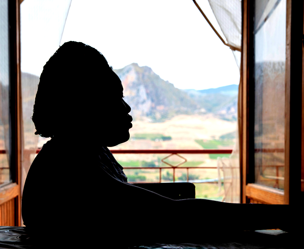 The silhouette of a woman at a shelter for Nigerian women in Sicily, Italy