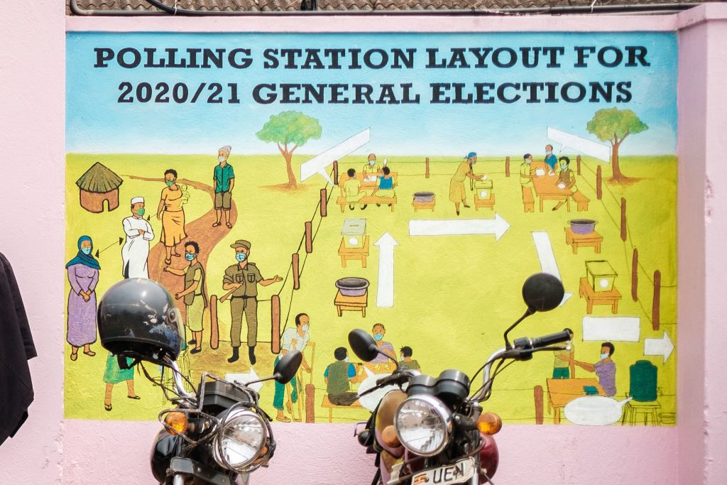 Graffiti on a wall shows a polling station's layout at the electoral commission headquarters in Kampala, Uganda