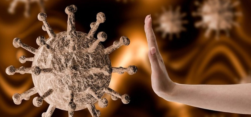 Representation of the virus and a hand