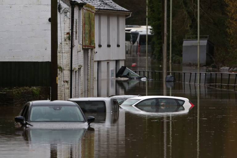 Cars sit submerged in flood water after the River Taff burst its banks in Nantgarw, south of Ponypridd in south Wales on February 16, 2020