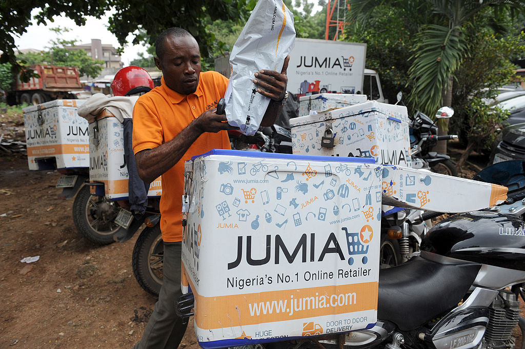 A Jumia scooterman arranges product to be delivered to clients at the Ikeja warehouse of the company in lagos on June 12, 2013