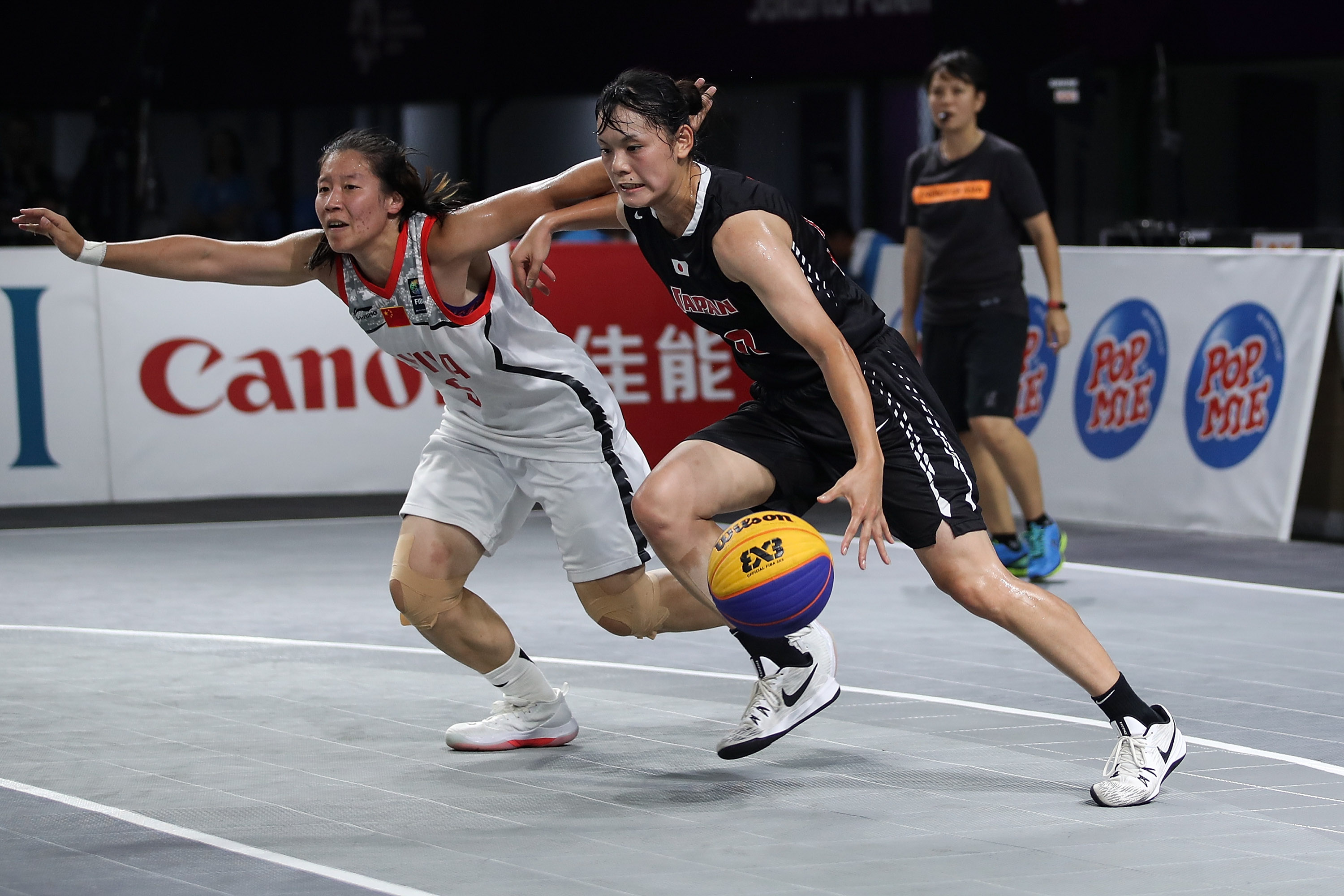 Li Yingyun of China and Okuyama Ririka of Japan in action during Women's Basketball 3X3 Final between China and Japan at the Asian Games on August 26, 2018 in Jakarta, Indonesia.