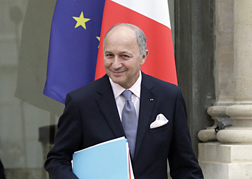 Then-French foreign minister Laurent Fabius holding some folders