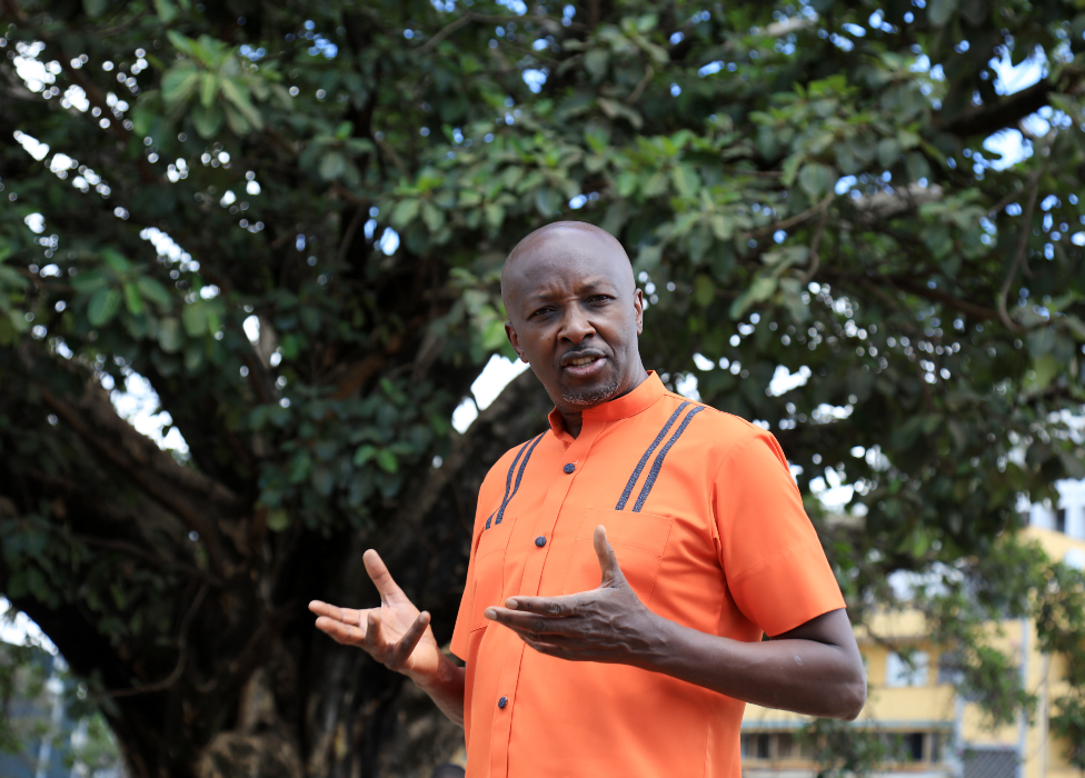 Joseph Warungu in front of Nairobi's famous fig tree
