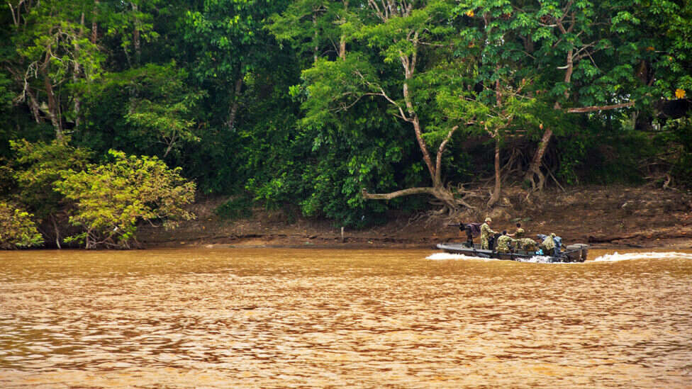 Colombian soldiers patrol the Guayabero River, near La Macarena, in 2010