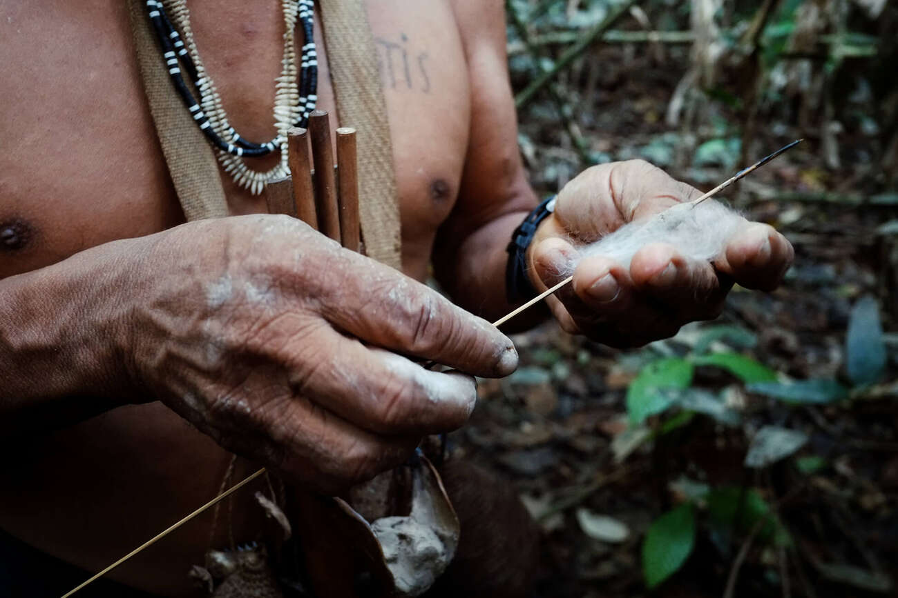 Indigenous hunter in the Amazon using a weapon