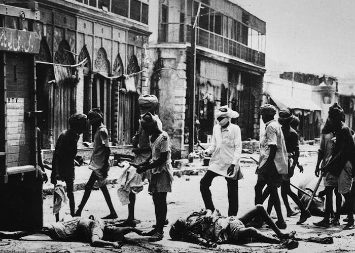 Bodies removed from a street after rioting in Delhi(Getty Images)