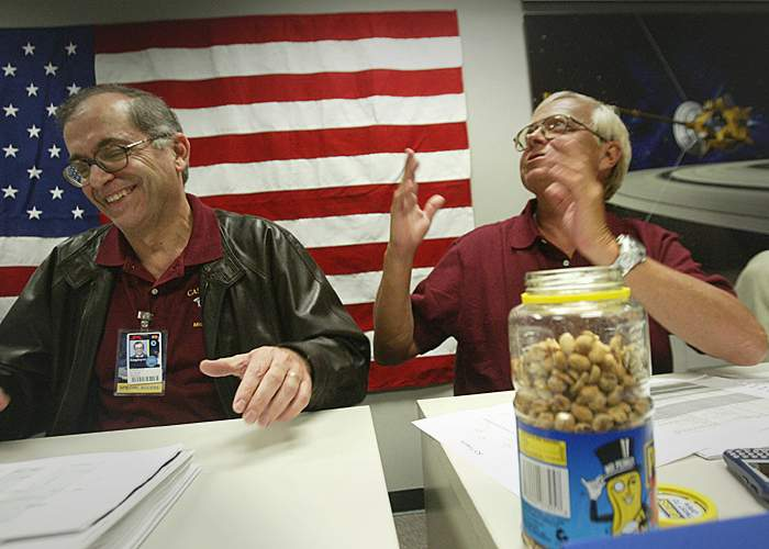 Charles Elachi (l) and Ed Weiler (r) - with their peanuts - celebrate Cassini's crucial Saturn Orbit Insertion(Getty Images)