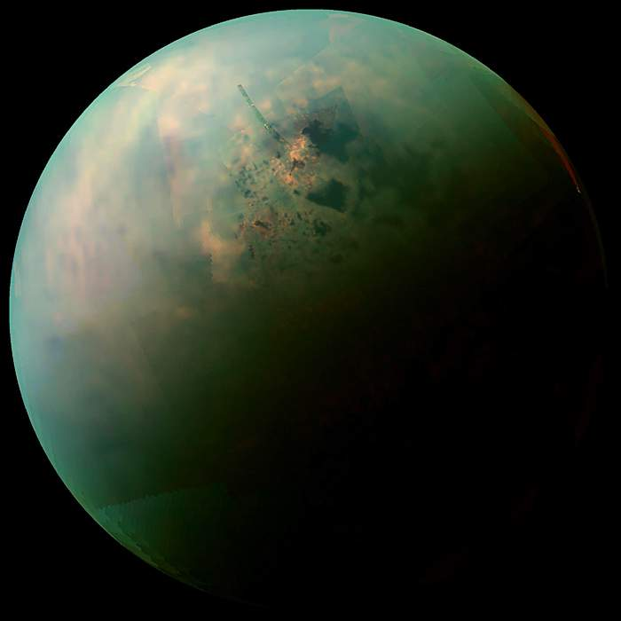 A false-colour mosaic of Titan made from infrared data - revealing differences in the composition of surface materials around hydrocarbon lakes(Nasa)