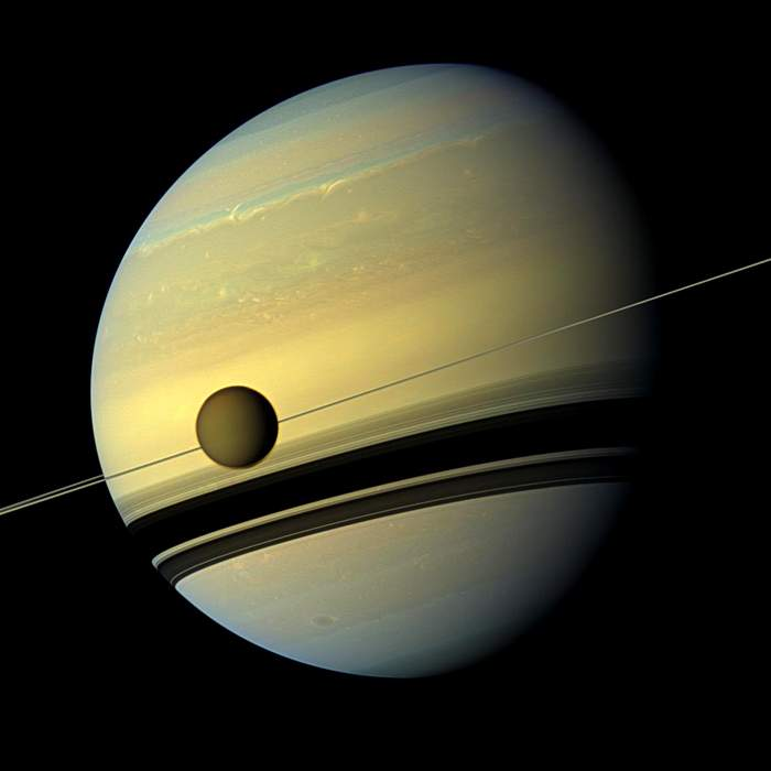 Cassini's view of Saturn and its moon Titan(Nasa)