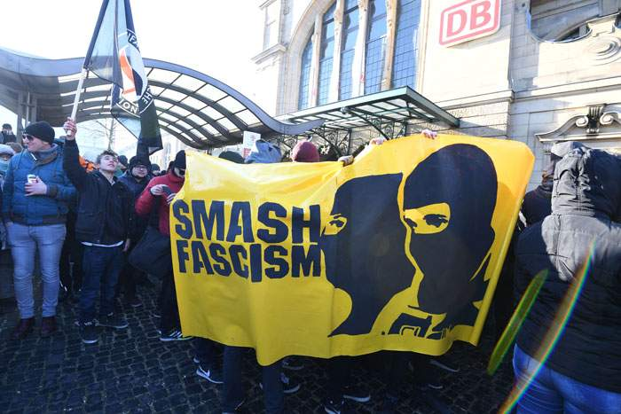 Protesters demonstrate outside the Koblenz event