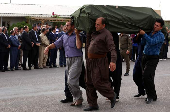 October 2015: Iraqi Kurdish men carry the body of one of 71 asylum seekers suffocated in an Austrian lorry