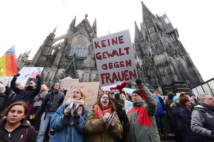 Demonstrators outside Cologne Cathedral protest at violence against women following the sexual assaults on New Year's Eve 2015