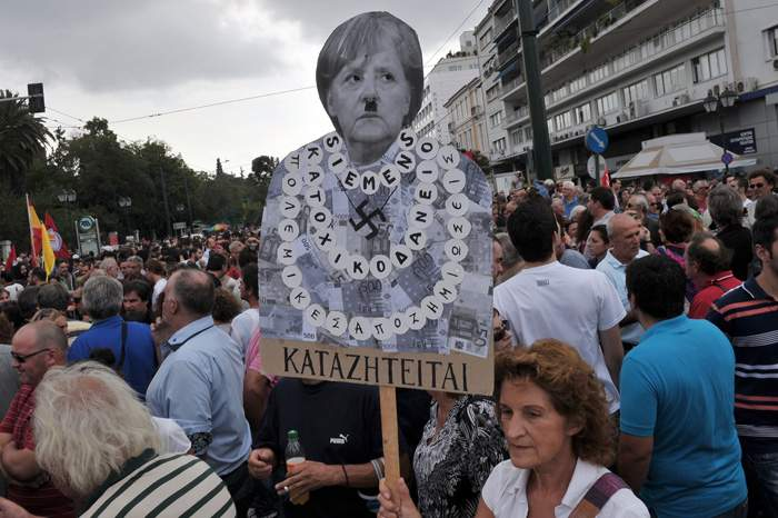 A 2012 protest in Athens against EU austerity measures depicts Merkel as Hitler