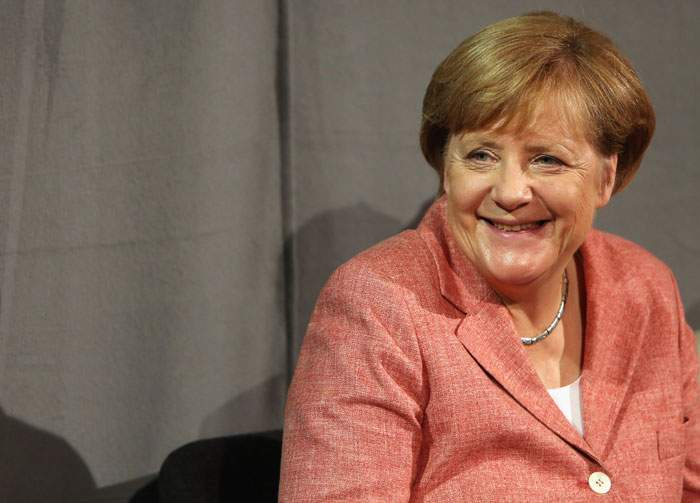 "According to Wolgang Bosbach, Merkel ""has a very good sense of humour..."""