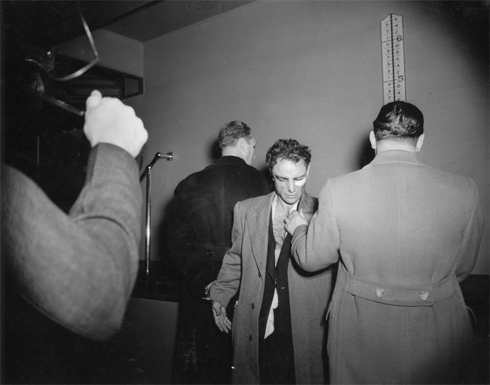 Anthony Esposito, held for murdering a businessman and police officer in the 'Battle of Fifth Avenue', 1941, Weegee
